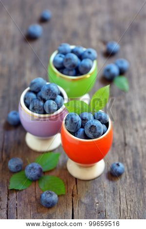Fresh Blueberries on old wooden table