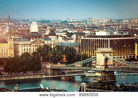 evening view on chain bridge and Budapest in lights