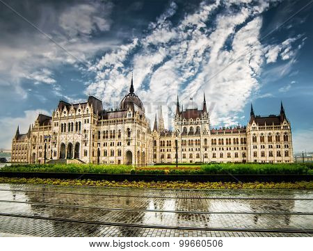 Hungarian Parliament building with reflection against sky in Budapest, Hungary