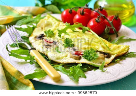 Omelet Stuffed With Champignon And Cheese.