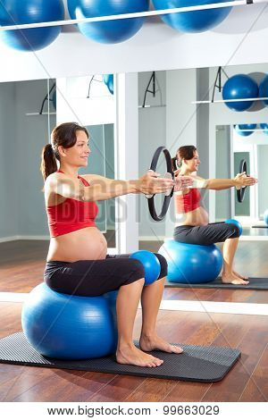 pregnant woman pilates exercise magic ring with fitball