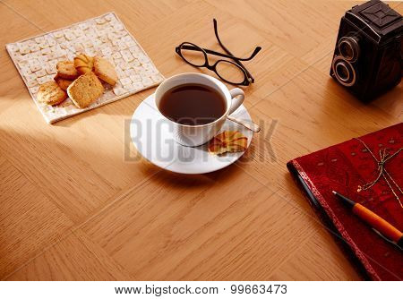 Morning breakfast coffee with vintage red notebook and biscuits