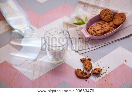 kids table with milk and cookies breakfast in pink colors