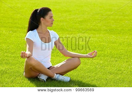 Young woman do sport on a play-ground