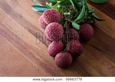 Lychee With Leaves On A Wooden Board, Still Life