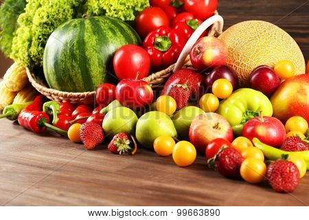 Composition with fresh fruits and vegetables on wooden table, closeup