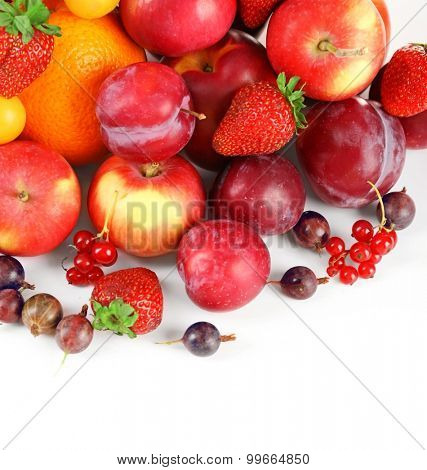 Heap of fresh fruits and berries  isolated on white