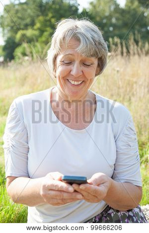 Old age woman using smart phone