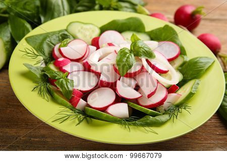 Fresh vegetable salad on table close up