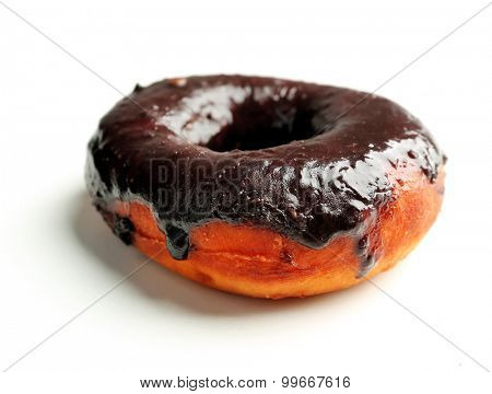 Delicious doughnut with chocolate icing isolated on white