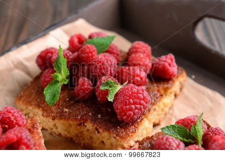 Fresh pie with raspberry in tray, closeup