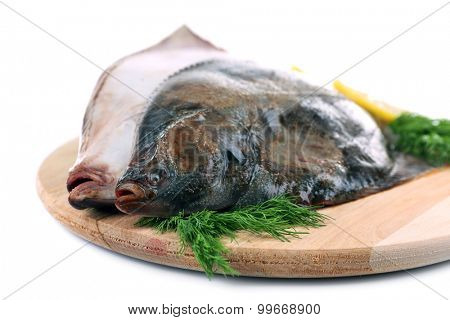 Fresh fishes on cutting board close up
