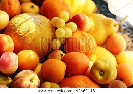 Heap of fresh fruits on tray close up