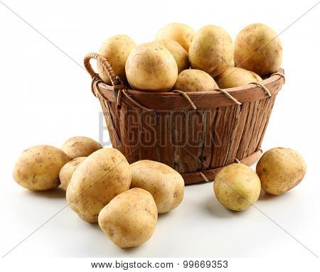 Young potatoes in basket isolated on white
