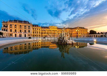 VIENNA - JULY 23 2015: Schonbrunn Palace, Vienna, Austria illuminated by sunset on July 23, 2015. The 1441-room palace is the major tourist attraction in Austria since 1960s.