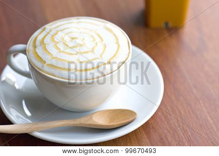 A Cup Of Coffee On Wooden Table.
