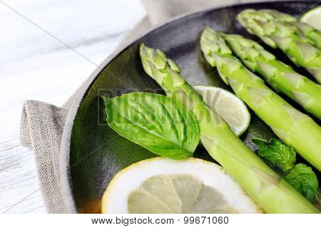 Fresh asparagus on pan, close-up