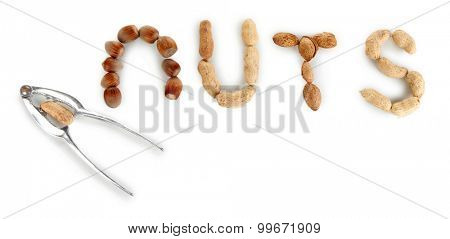 Nutcracker with nuts isolated on white