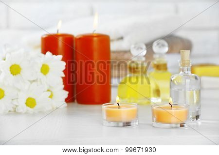 Composition of spa treatment on table, on white background