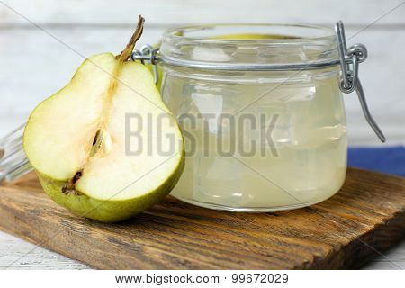 Pear juice with fresh fruit and cinnamon on table close up