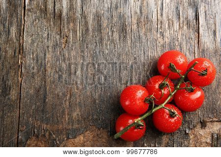 Pile of cherry tomatoes on wooden background