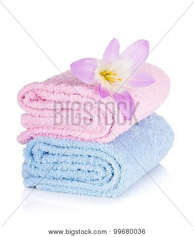 Pink and blue towels and flower. Isolated on white background