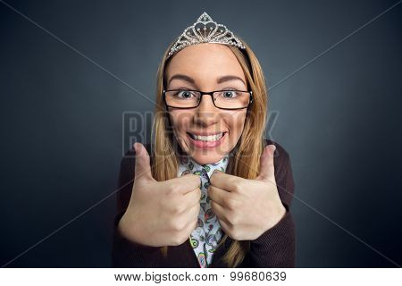 Teen nerd prom queen showing thumbs up