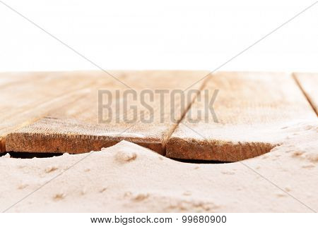 Sand with wooden planks isolated on white