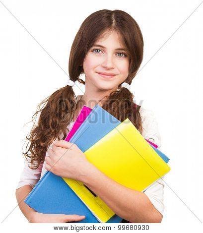 Portrait of cute brunette schoolgirl holding in hands three colorful notebooks, isolated on white background, back to school concept