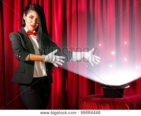 Magician Showing To A Hat With Lights And Fumes Going Out