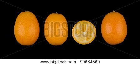 Four Oval Kumquats In A Row On Black Background