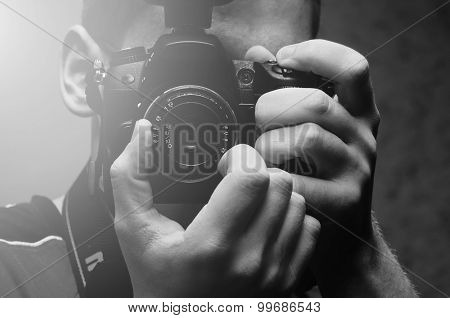 Black and white photo of a photographer and camera