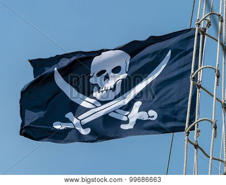 The pirate flag on the mast.