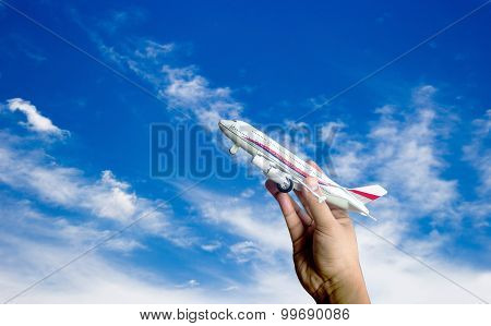 Hand Hold Aeroplane Toy On Blue Sky