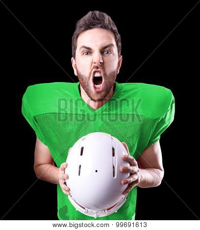 Football Player on green uniform isolated on black background