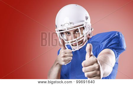 Football Player on blue uniform isolated on red background