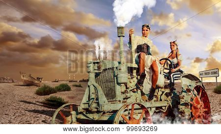 Two Sexy Woman In The Steam-punk Clothes Are Driving Vintage Tractor On The Apocalypse Background.