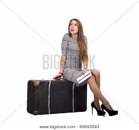 Female tourist with large old-fashioned suitcase
