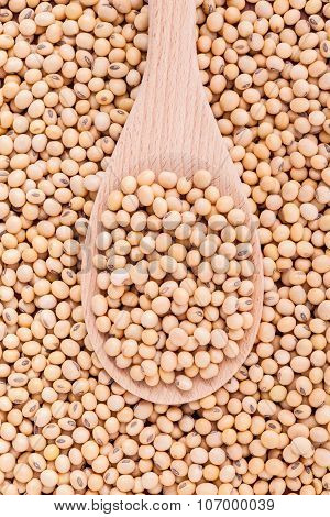 Close Up Soy Beans In Wooden Spoon And Soy Beans Background.