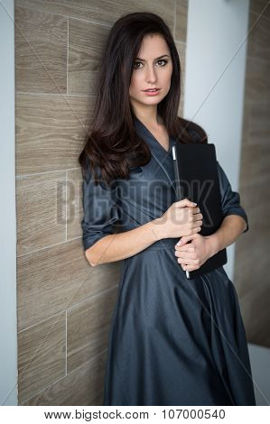 Business portrait slim pretty girl in a strict office clothes
