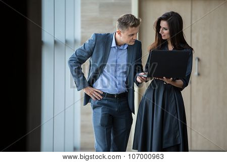 Business portrait of business couple.