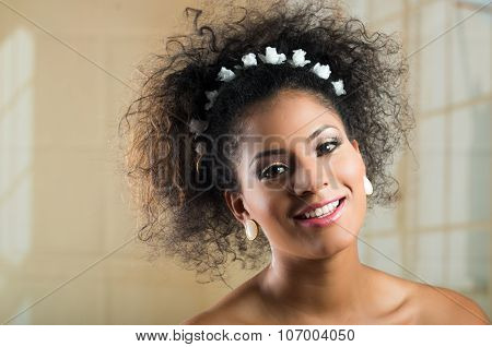 Closeup portrait of beautiful hispanic young woman with curly hair
