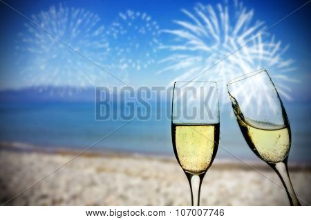 New Year at the beach - Glasses of champagne on the beach against the sky and blue sea