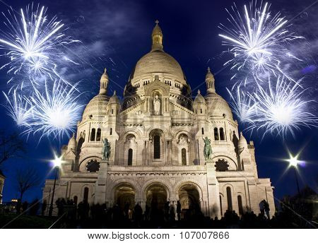The Sacre Coeur church with fireworks, celebration of the New Year in Paris, France