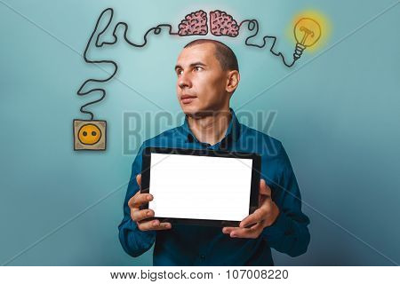 a man looking away and holding a tablet in the hands of a white