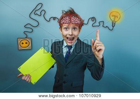 boy with shaggy head teenage businessman raised his finger initi