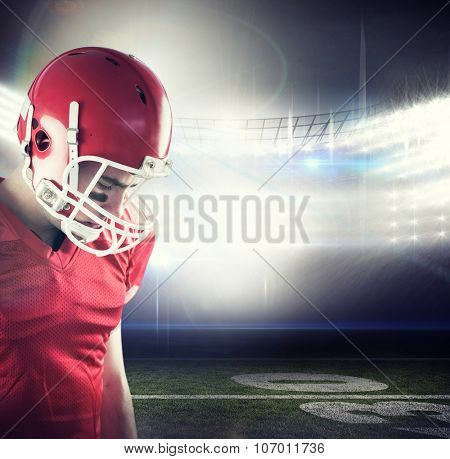 Amercian football player having his helmet on her head against american football arena