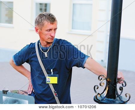 The Thoughtful Man Leans A Hand Against A Metal Column