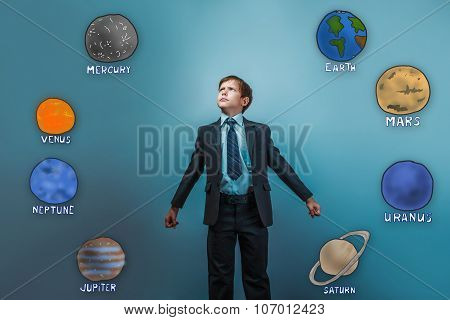 boy businessman standing in a heroic pose success victory of pla