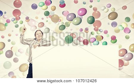 Stout woman of middle age pointing at blank white banner